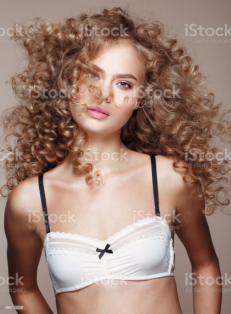 Model portrait with curly volume hairstyle stock photo