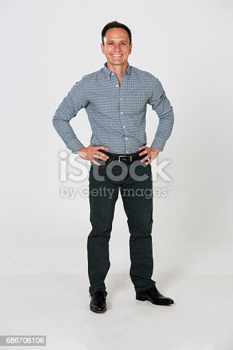 Model  with white background wearing jeans and collared shirt