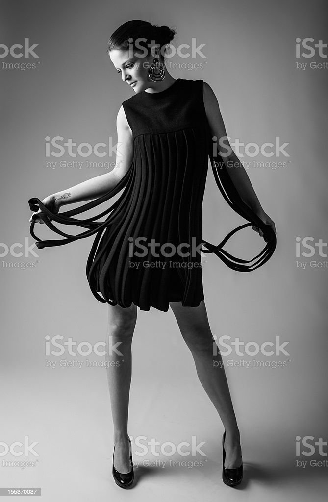 Model posing in a vintage sixties dress royalty-free stock photo