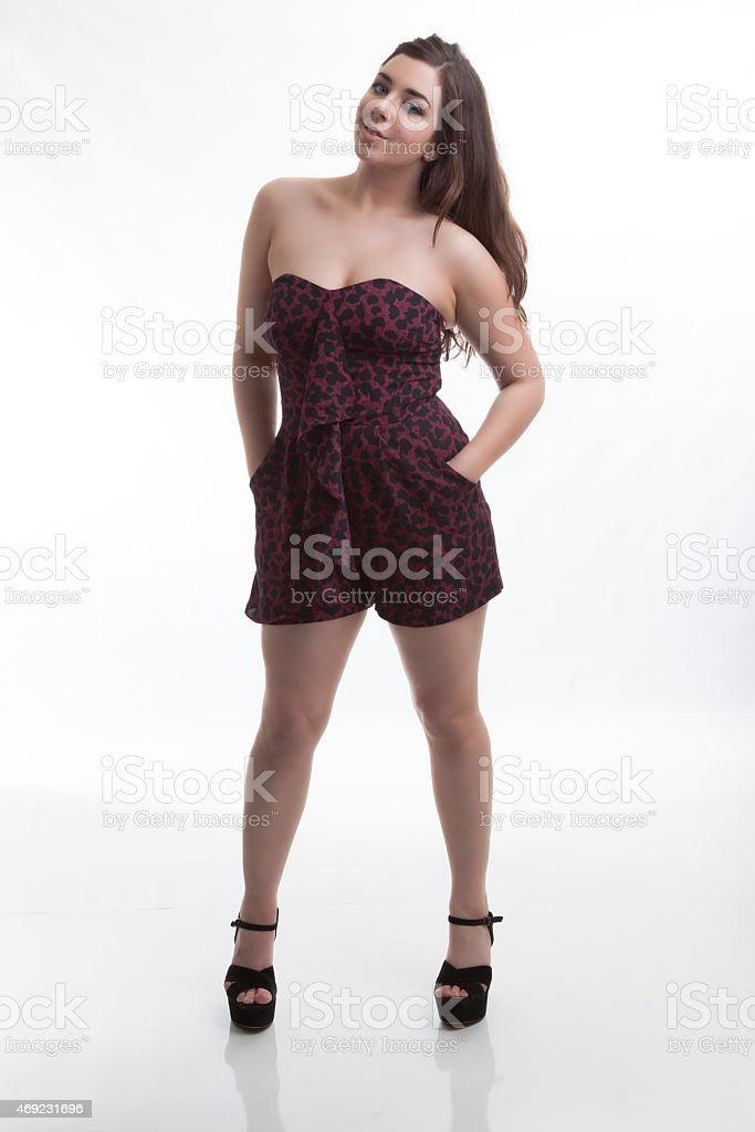 Model Posing Pink Spring Fashions and Standing in High Heels stock photo