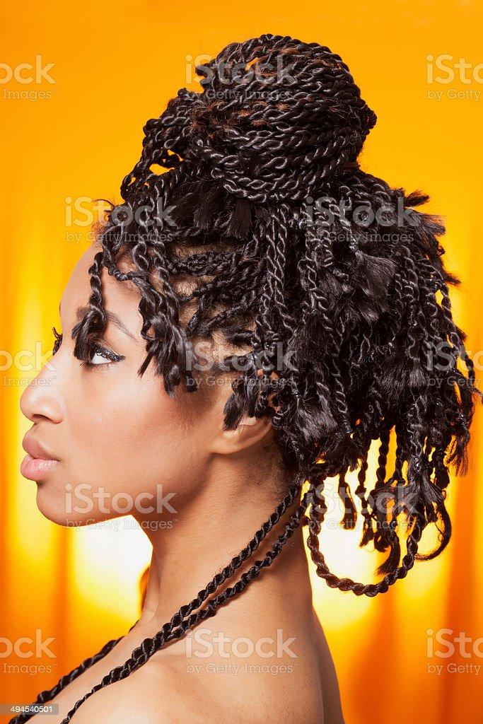 Model profile on orange background stock photo