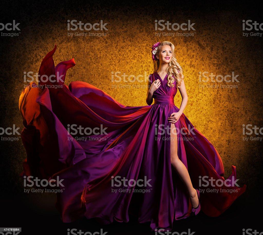 Model Purple Dress, Fashion Woman Posing Flying Silk Waving Cloth stock photo