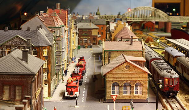 Model railroad layout with fire engines Model railroad layout with trains, fire brigade vehicles and houses. pejft stock pictures, royalty-free photos & images