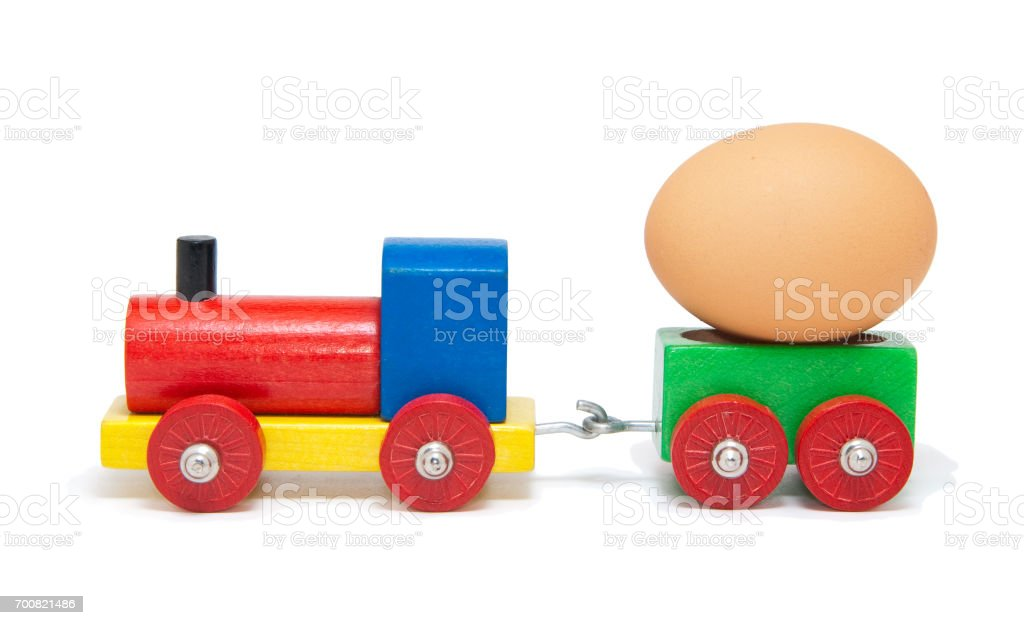 Model railway transporting an egg stock photo