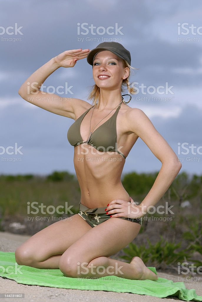 model salutes in camouflage swimwear royalty-free stock photo