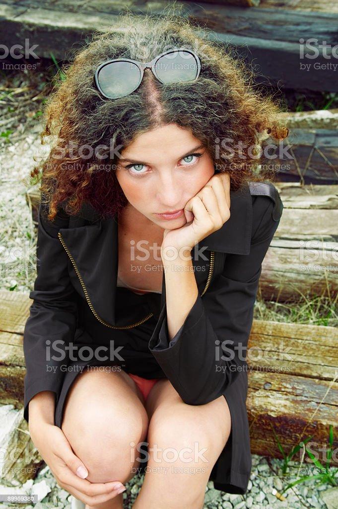 Model sitting on railway sleepers stock photo