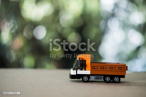 Model toy Thai trucks on wood table. Miniature truck