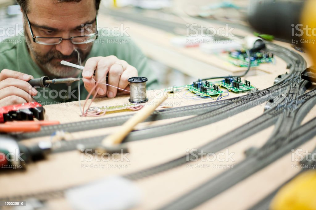 Model train builder working. stock photo