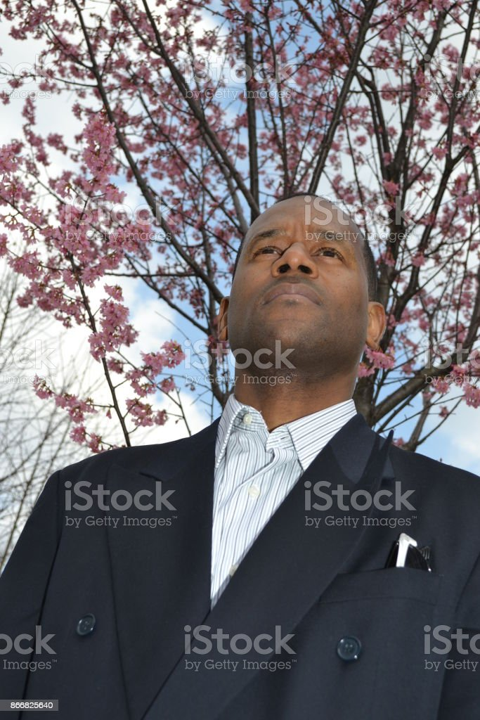 Model wearing a business suit looking ahead stock photo