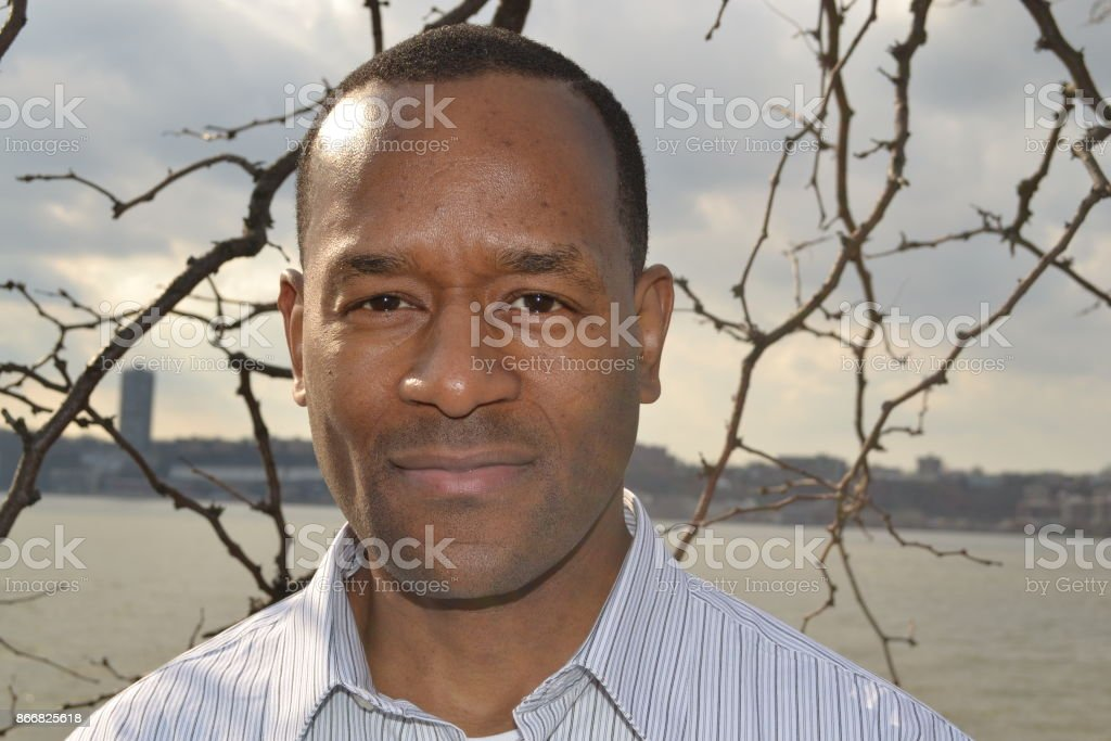 Model wearing a collared dress shirt near Riverside, New York City stock photo
