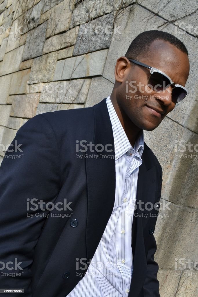 Model wearing a suit jacket, collared dress shirt and shades (Full Color) stock photo