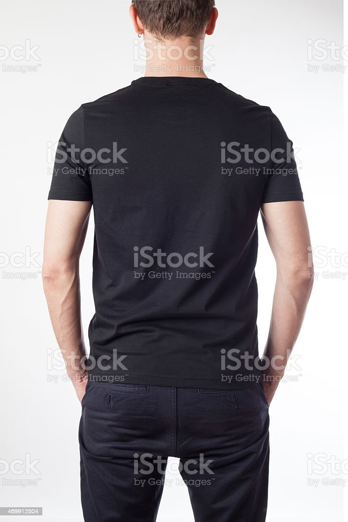 Model wearing black t-shirt ready for your graphic design stock photo