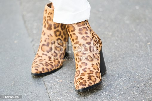 istock Model wears a pair of leopard-print boots 1182680301
