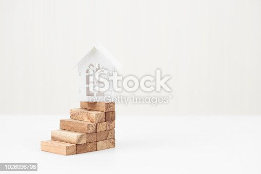 958039576istockphoto Model white house on wood block stacking step stair. Property investment and house mortgage financial concept, Home protect, Insurance. With copy space for your text. 1026096708