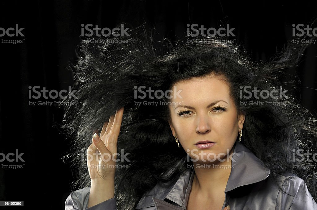 Model with beautiful long hair in motion created by wind royalty-free stock photo