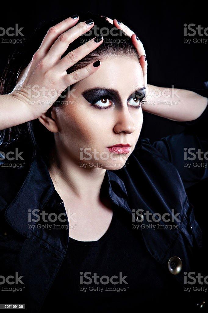 Model with dark fashion make-up stock photo