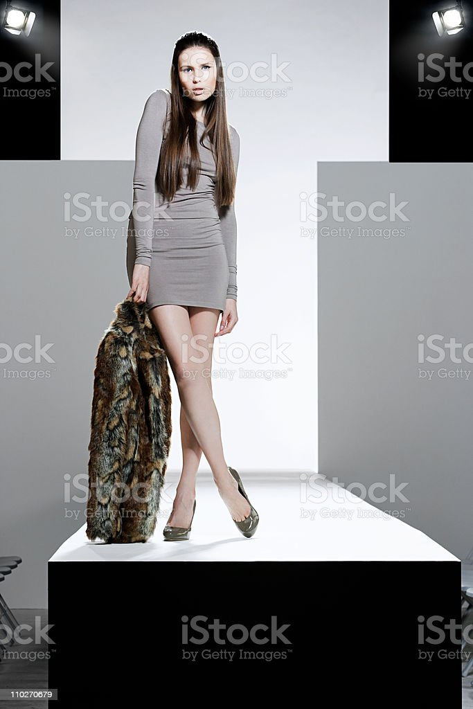 Model with fur coat on catwalk at fashion show stock photo