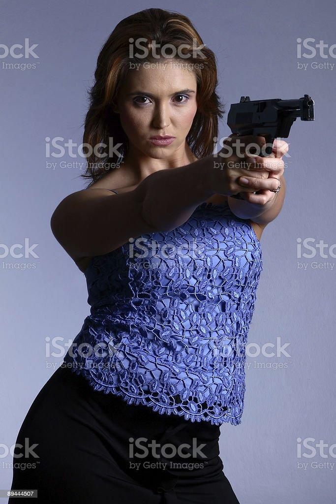 Model with gun royalty-free stock photo