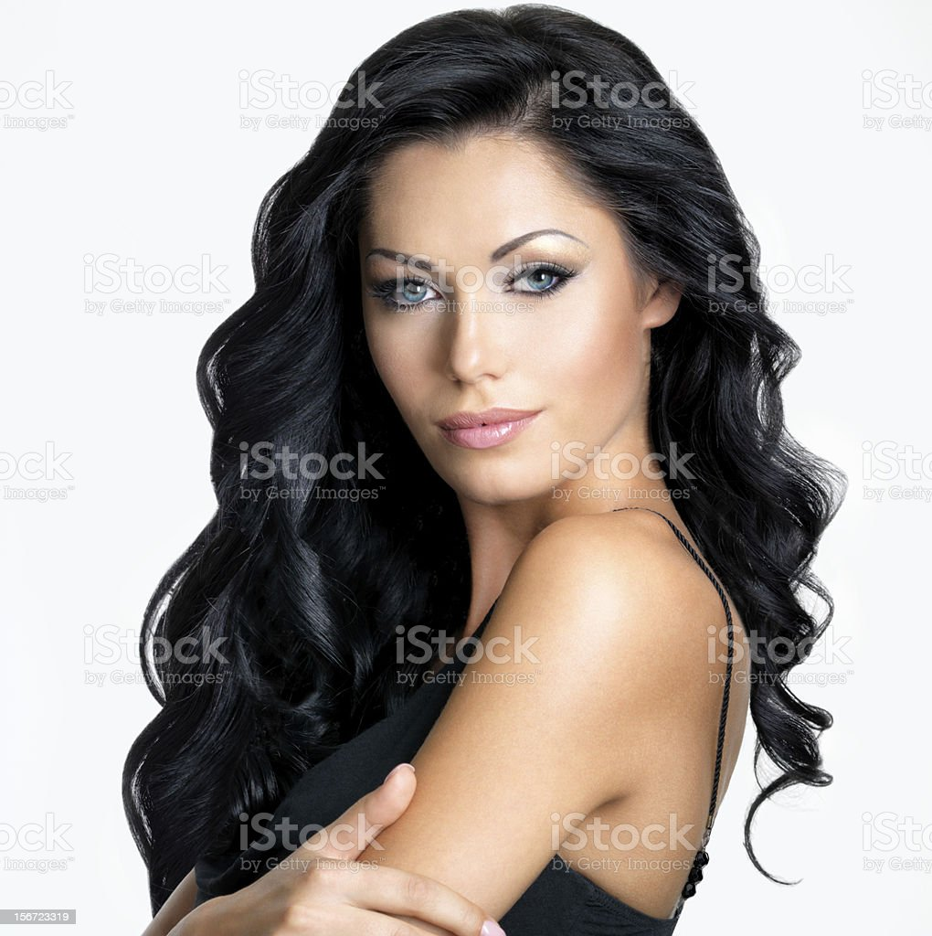 Model with long black hair on white background stock photo