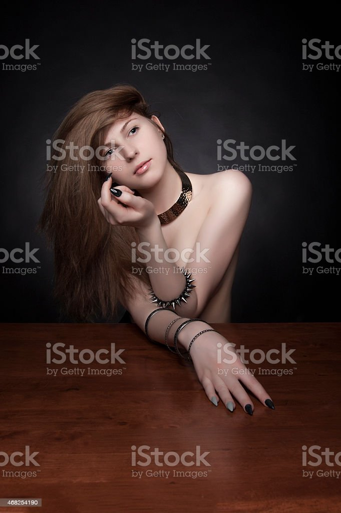 Model with long curly ginger red hair and natural make-up. stock photo