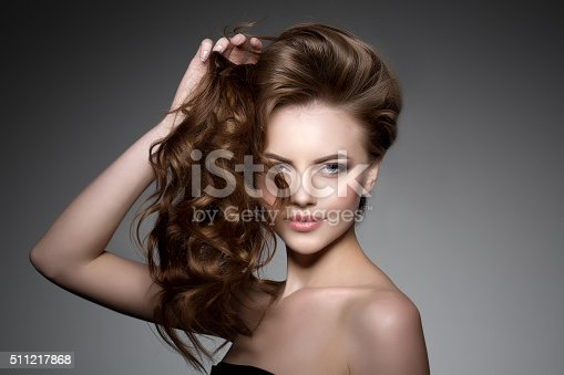 istock Model with long hair. Waves Curls Hairstyle. Hair Salon. Updo 511217868