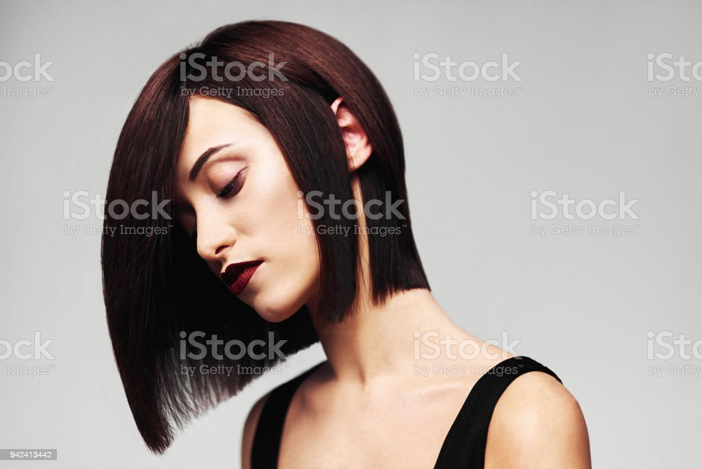Model with perfect long glossy brown hair. Close-up Bob haircut portrait stock photo