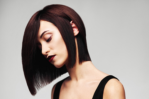 Model With Perfect Long Glossy Brown Hair Closeup Bob Haircut Portrait Stock Photo - Download Image Now