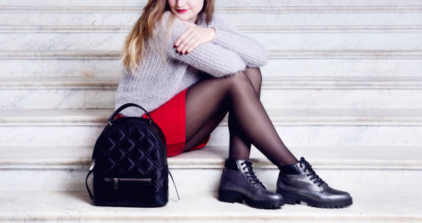 model woman legs in black boots with bag. - black women wearing pantyhose stock photos and pictures