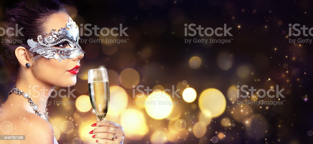Model Woman With Mask AndChampagne stock photo