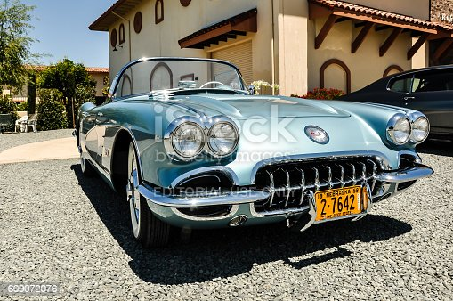Livermore, California, United States - July 8, 2014: A beautifully restored  1958 Corvette painted in the original GM colors displayed in front of the tasting room  of the Ruby Hills WInery in Livermore, CA