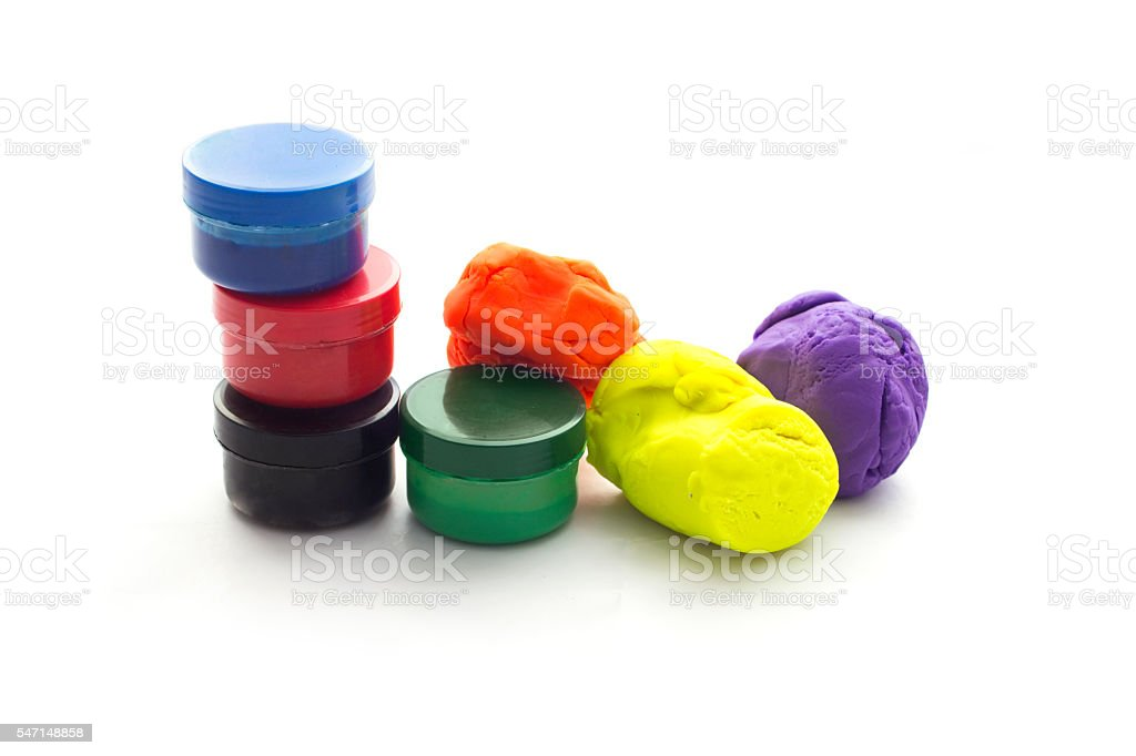 Modelling clay balls and painting on white stock photo