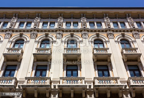 TRIESTE, Italy - June 16, 2019: Detail of the facade facing Piazza della Borsa of Modello Palace