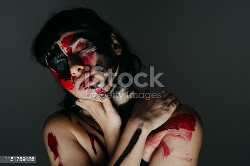 istock Model's face and body covered with paint 1151789128