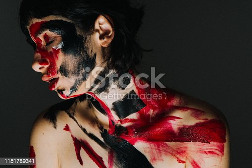 istock Model's face and body covered with paint 1151789341