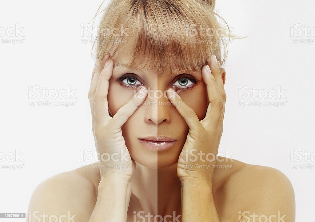 Model's face divided in two parts - tanned and natural. stock photo