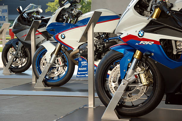 BMW S1000RR, HP2 SPORT, K1300S models Munich, Germany - May 23, 2010: BMW S 1000 RR, BMW HP2 SPORT and BMW K 1300 S motorcycles parked for exhibition right outside BMW Welt exhibition center. three wheel motorcycle stock pictures, royalty-free photos & images
