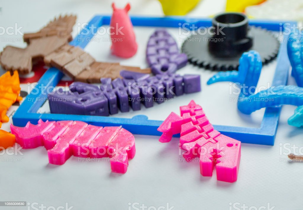 Models printed by 3d printer. Bright colorful objects printed on a 3d printer stock photo