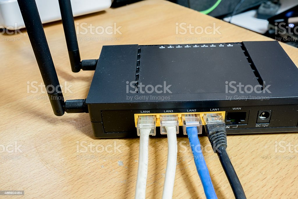 Modem router network hub with cable connecting stock photo
