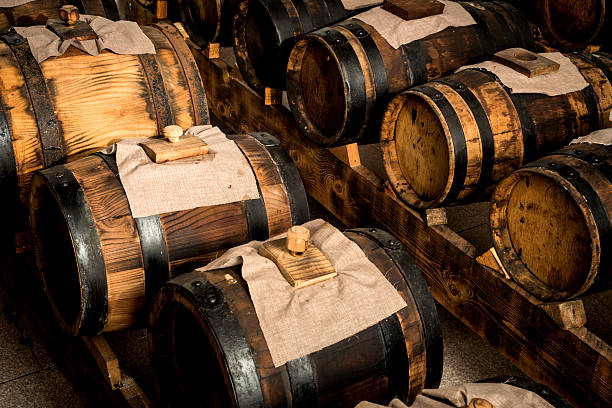 modena balsamic vinegar modena balsamic vinegar barrels for storing and aging balsamic vinegar stock pictures, royalty-free photos & images
