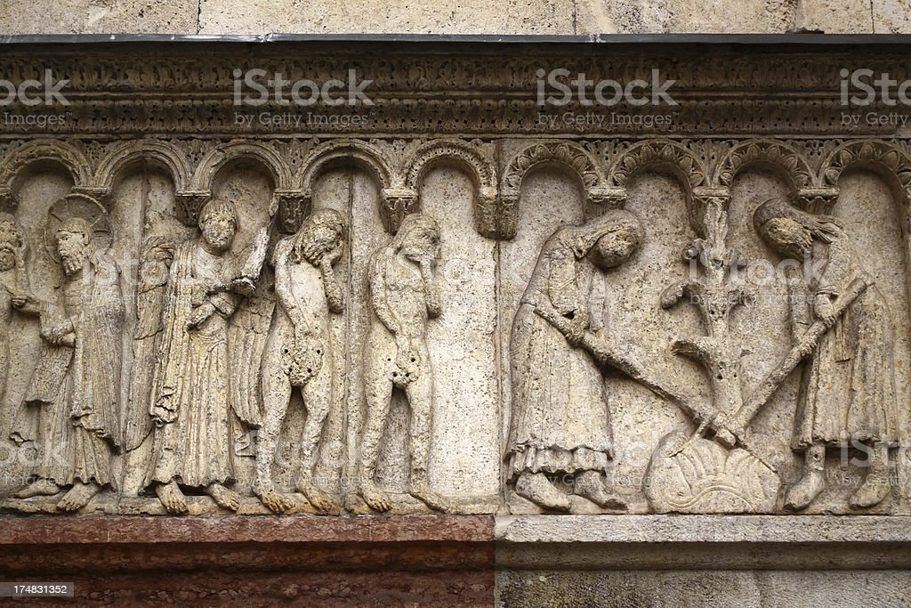 Modena, Cathedral: Bas relief at the main gate royalty-free stock photo