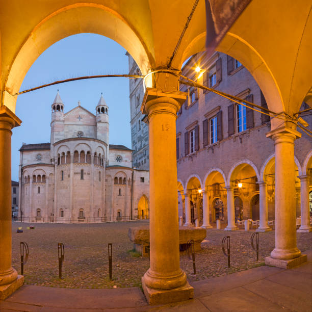 Modena - The porticoes on the Piazza Grande square at dusk with the Dome. Modena - The porticoes on the Piazza Grande square at dusk with the Dome. piazza grande stock pictures, royalty-free photos & images