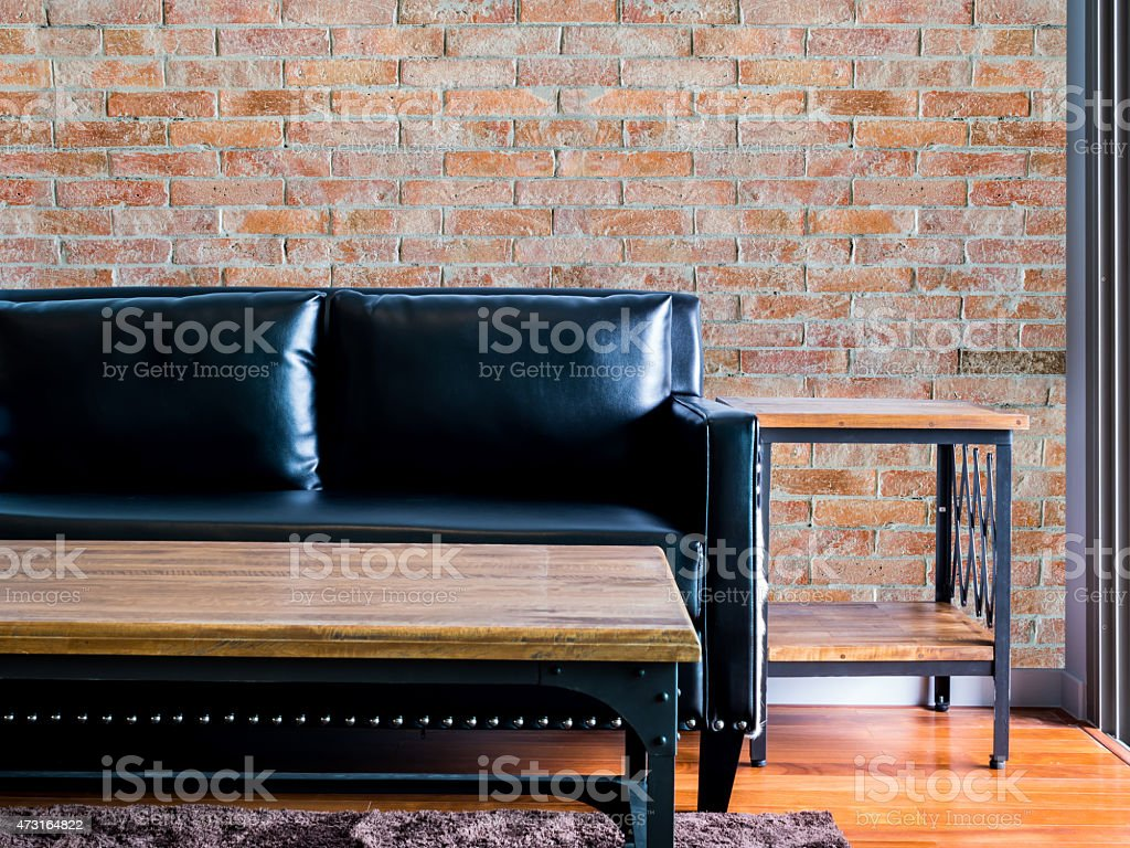 Moderm Living room Interior design with black couch/ brick wall stock photo