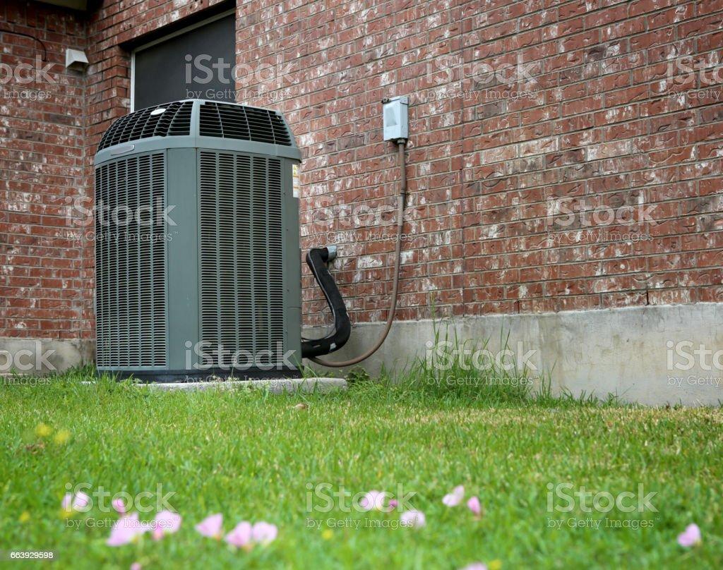Modern AC High efficiency modern AC-heater unit on brick wall background Air Conditioner Stock Photo