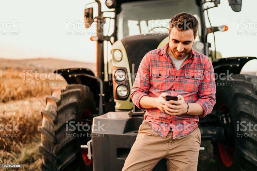Modern agriculture with technology and machinery concept stock photo