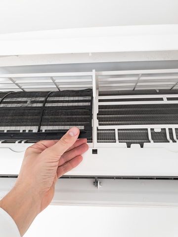 istock Modern airconditioner unit service cleaning the filter to prevent respiratory disease. 1206226181