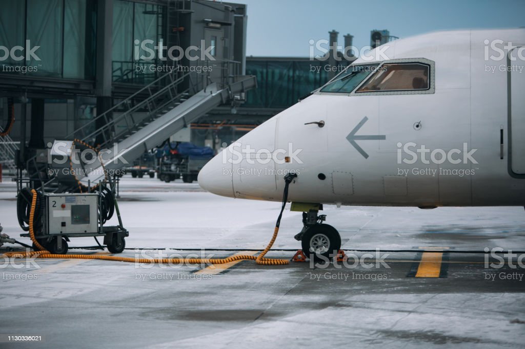 Modern airplane near terminal with GPU