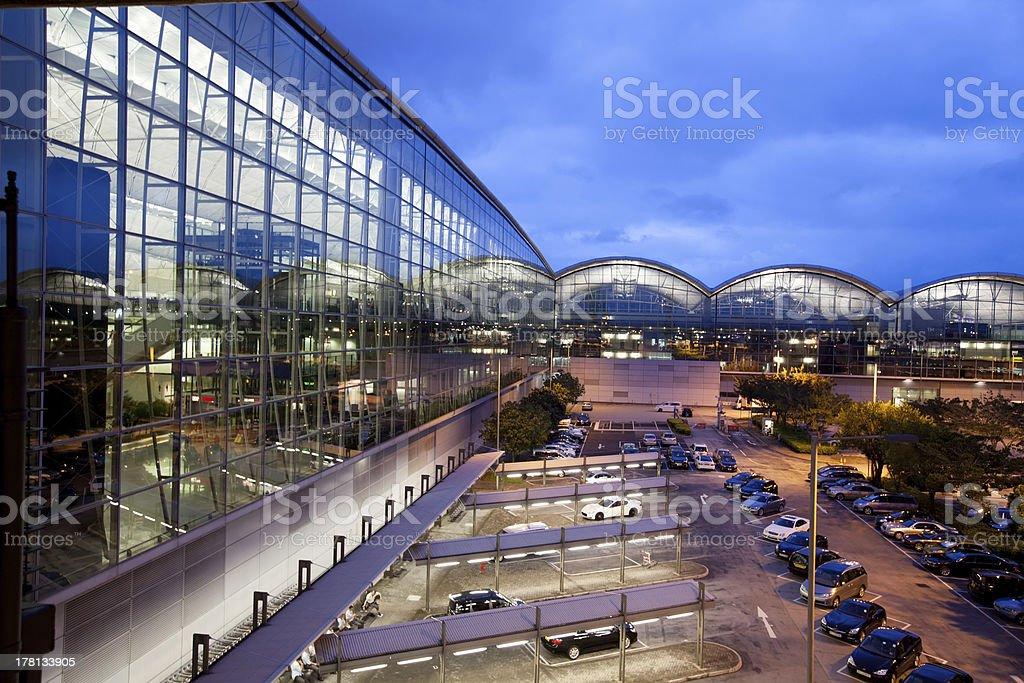 modern airport in hongkong at night stock photo