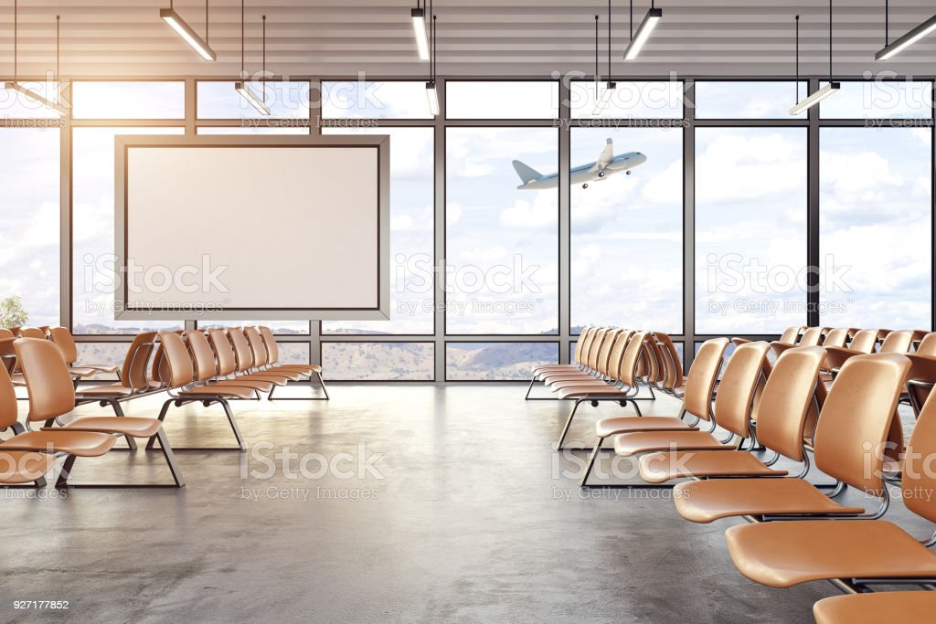 Modern airport interior with blank poster stock photo