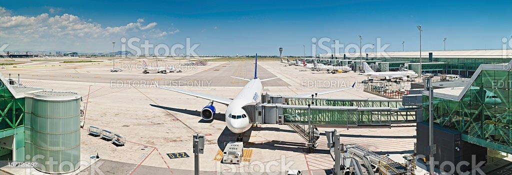 Modern airport panorama aircraft jet bridge terminal stock photo