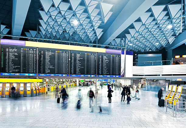 modern airport - airport check in counter stock pictures, royalty-free photos & images